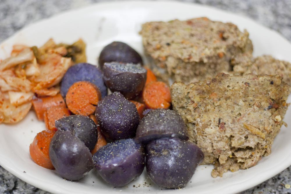 meatloaf, turkey and grass fed beef meatloaf, purple potatoes, carrots, steamed vegetables, kimchi