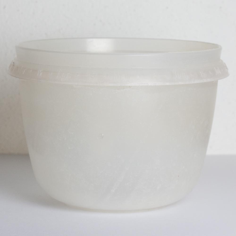 I keep this old plastic 1 1/2 cup storage container in the shower for diluting the baking soda and vinegar.