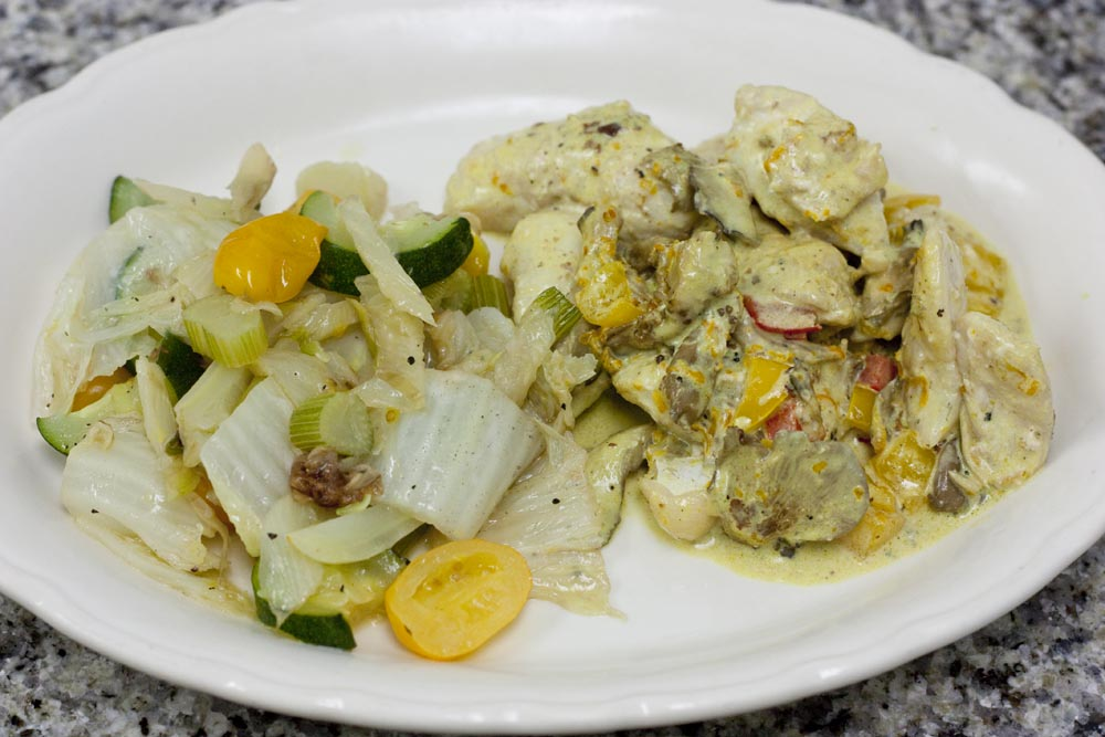 Grouper cheeks with orange cream sauce along with sauteed fennel, Napa cabbage, zucchini squash and yellow grape tomatoes.