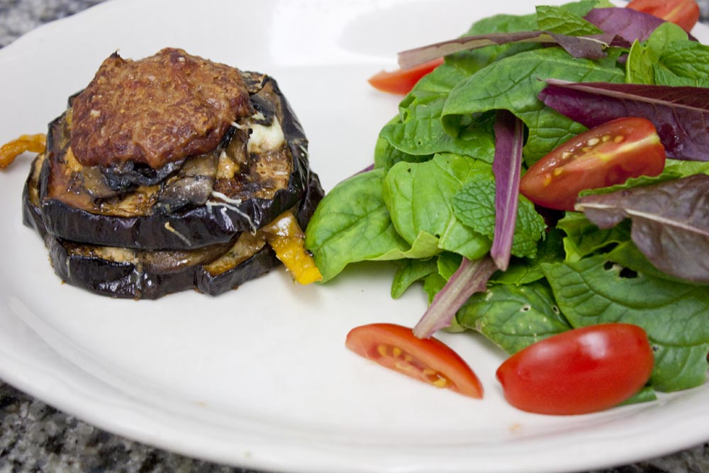 Eggplant Parmesan stack with a green salad.