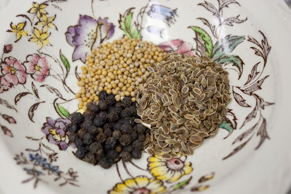 whole dill seed, whole yellow mustard seed and whole black peppercorns