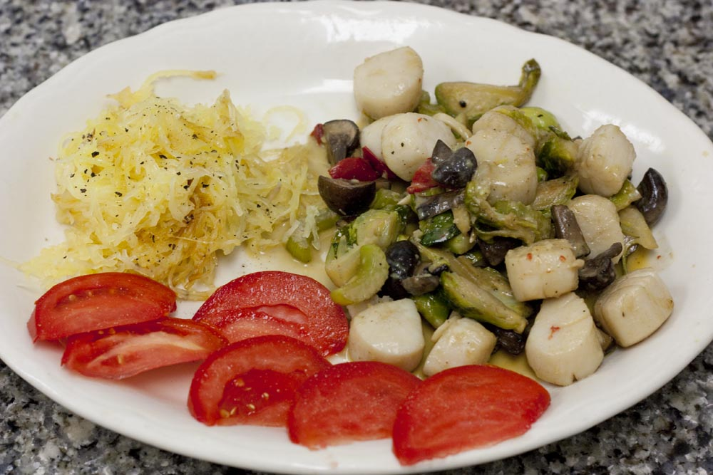 Creamy horseradish scallops with spaghetti squash and fresh tomato makes a healthy whole food meal.